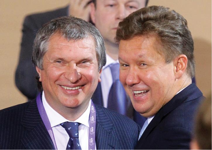 Ближайшие соратники Путина Игорь Сечин и Алексей Миллер.